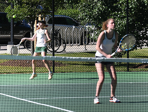 JIM VAIKNORAS/Staff photo Manchester-Essex Andrea Rennie returns a shot against Ursuline Academy she is playing alongside Auguats Kahle in the 2nd doubles match at Newton North High school Tuesday.