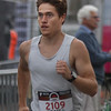 MIKE SPRINGER/Staff photo<br /> Mike Darnell of Brooklyn, New York runs to victory Thursday evening in the Fiesta 5K Road Race in Gloucester.<br /> 7/28/2018