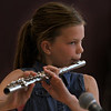 MIKE SPRINGER/Staff photo<br /> Fifth-grader Chloe Young plays the flute during the annual year-end talent show Monday at West Parish Elementary School in Gloucester.<br /> 6/18/2018