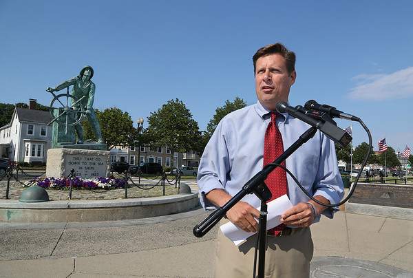MIKE SPRINGER/Staff photo<br /> State Rep. Geoff Diehl, Republican candidate for U.S. Senate, makes a campaign stop Thursday in front of the Fishermen's Memorial statue in Gloucester to call attention to his plans for fishing industry policy.<br /> 6/21/2018