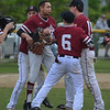 MIKE SPRINGER/Staff photo<br /> Gloucester pitcher John John Mondello is congratulated by his teammates after the Fishermen beat Triton 5-1 in Division 3 North first round baseball playoffs Thursday in Gloucester.<br /> 6/7/2018