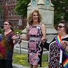 """MIKE SPRINGER/Staff photo<br /> Gloucester Mayor Sefatia Romeo Theken, right, clasps hands with Alasandra McClellan, right, of Gloucester and """"Dutchess Gigi"""" Gill of Salem during a rainbow flag raising ceremony in celebration of Gay Pride Month at Gloucester City Hall. More than 50 people attended the event.<br /> 6/7/2018"""