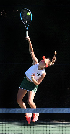 JIM VAIKNORAS/Staff photo Manchester-Essex 1st singles player Olivia Mariotti serves in her match against Ursuline Academy's Margaret Daily at Newton North High school Tuesday.