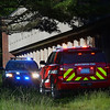 MIKE SPRINGER/Staff photo<br /> Police and fire vehicles resond late Wednesday afternoon to a report of a possible structure fire at the abandoned Fuller School in Gloucester. A police officer on the scene said that some kids had started a fire in a garbage can and were taken into custody.<br /> 6/6/2018