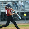 CARL RUSSO/staff photo. Base hit for Riley Thibodeau. Gloucester vs. Burlington Softball, Division 2 North Semifinals. 6/13/2018
