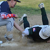 MIKE SPRINGER/Staff photo<br /> Jackson Levendusky of Manchester Essex slides back to first as the ball slips from the glove of Saint Joseph's Prep first baseman Aidan Newell during Division 4 North first round playoffs Friday in Essex.<br /> 6/8/2018