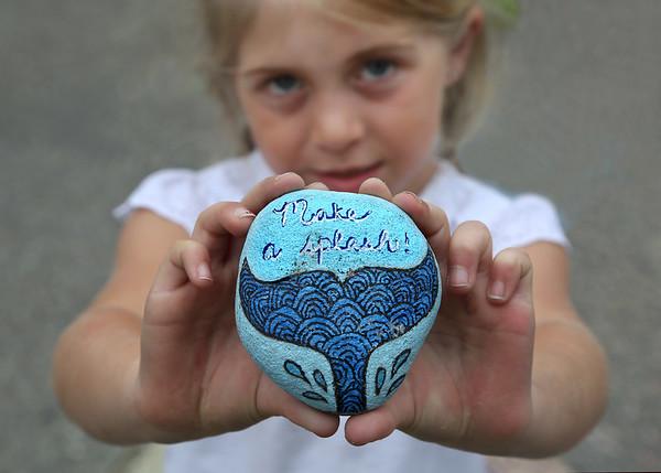 """MIKE SPRINGER/Staff photo<br /> Taylor Warren, 6, holds her favorite """"Glosta Rock.""""<br /> 6/14/2018"""