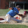 MIKE SPRINGER/Staff photo<br /> Dracut first baseman Austin Chausse puts the tag on Gloucester's Jared Lucido too late to make the out during Division 3 North baseball quarterfinals Monday in Gloucester. Dracut won the game, 3-2.<br /> 6/11/2018