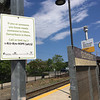 ANDREA HOLBROOK/Staff photo/Signs urging people to call for help if they're thinking about suicide, like this one at the Gloucester train station ion Railraod Avenue, have been appearing at MBTA stations on Cape Ann and the North Shore.