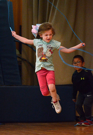 """MIKE SPRINGER/Staff photo<br /> Kindergartner Natalie Parisi participates in a """"World of Rope Jumping"""" program Wednesday at Veterans Memorial Elementary School in Gloucester. The visiting program, led by Mark Rothstein of Sedona, Arizona, incorporates jump roping into lessons on overall cardio-vascular health and character-building.<br /> 6/6/2018"""