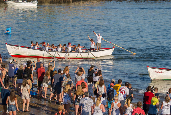AMANDA SABGA/Staff photo<br /> <br /> Up Roar teammates make finishing strides during Friday night's St. Peter's Fiesta's girls seine bot race at Gloucester's Pavilion Beach. <br /> <br /> 6/29/18