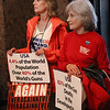 MIKE SPRINGER/Staff photo<br /> Barbara McLaughlin, left, and Leslie Pearlman, both of Gloucester, hold signs during a National Gun Violence Awareness Day event Friday at Gloucester City Hall.<br /> 6/1/2018
