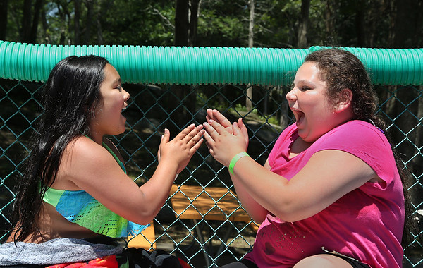 """MIKE SPRINGER/Staff photo<br /> Ten-year-olds Brooke Tavares, left, and Isabella Cassettari play the """"ABC"""" hand-clapping game together after taking a swim at the Cape Ann YMCA's Camp Spindrift in Gloucester.<br /> 6/21/2018"""