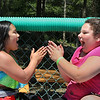 "MIKE SPRINGER/Staff photo<br /> Ten-year-olds Brooke Tavares, left, and Isabella Cassettari play the ""ABC"" hand-clapping game together after taking a swim at the Cape Ann YMCA's Camp Spindrift in Gloucester.<br /> 6/21/2018"