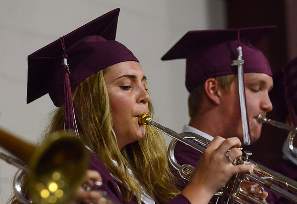 MIKE SPRINGER/Staff photo<br /> Graduating seniors Charlotte Joan Salmon and Henry Phillip Prentiss perform for the last time with the Jazz Ensemble I during the 2018 graduation ceremony Friday at Rockport High School. Sixty-seven seniors graduated.<br /> 6/1/2018