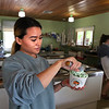 MIKE SPRINGER/Staff photo<br /> Mia Ciavola, manager of DownRiver Ice Cream in Essex, scoops ice cream into a compostable cup.<br /> 6/15/2018