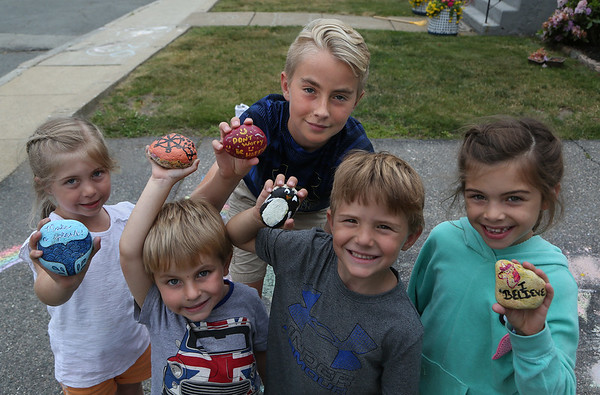 "MIKE SPRINGER/Staff photo<br /> From left, Taylor Warren, 6, Dax McElhenny, 4, Luke McElhenny, 12, Cormac McKay, 5, and Daniella Orlando, 8, hold ""Glosta Rocks.""<br /> 6/15/2018"