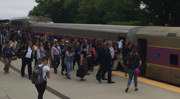 CHRISTIAN M. WADE/CNHI photo/Passengers board a commuter rail train at Salem Depot on its way into Boston's North Station. On-time performance by the MBTA commuter rail system, including the Newburyport/Rockport and Haverhill lines, averaged 90% over the past year, according to the MBTA.