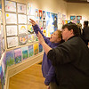 Vincenzo Dimino photo<br /> Rockport resident Stacey Whiten and Rockport seventh-grader Madison Slier checking out work at the Rockport Public Schools' Annual Pre-K to Grade 12 Art Show.