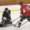 TIM JEAN/Staff photo<br /> Dawgz's Jerry Ciaramitaro, right,  is denied a goal by Black Bears goaltender Anthony Cusamano during 10th Annual Father and Son hockey game at Talbot Rink in Gloucester.   3/25/17