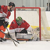 TIM JEAN/Staff photo<br /> At right, Dawgz's goaltender Derric Saza makes a save during 10th Annual Father and Son hockey game at Talbot Rink in Gloucester.   3/25/17