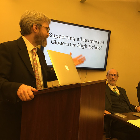 RAY LAMONT/Staff photo/Gloucester High Principal James Cook, left, discusses his presentation on the school's dropout rates as Superintendent Richard Safier watches at Wednesday's School Committee meeting.