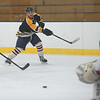 TIM JEAN/Staff photo<br /> Black Bears's Kevin Mazzeo, center, shoots the puck toward the net a scoring chance during 10th Annual Father and Son hockey game at Talbot Rink in Gloucester.   3/25/17