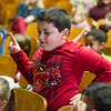 Desi Smith Photo.     Lorenzo Taormina does his own freestyle from his seat as members of Illstyle and Peace, a Philadelphia-based Dance Troupe perform on stage Monday morning at East Gloucester Elementary School. The performance was sponsored by the East Gloucester PTO and funded in part by a grant from the Gloucester Cultural Council. March 6,2017
