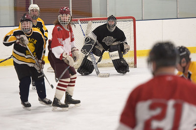 TIM JEAN/Staff photo Black Bears goaltender Anthony Cusamano, center, watches the action during 10th Annual Father and Son hockey game at Talbot Rink in Gloucester.   3/25/17