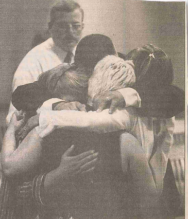 "JOSH REYNOLDS/Staff file photo<br /> Relatives of Florence ""Bunny"" Monroe hug after Barbara Goucher was sentenced to life in prison after pleading guilty to second-degree murder in Lawrence Superior Court in July 1999."