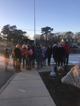 MARY MARKOS/Staff photo<br /> A group of protestors hold vigil outside an anti-sanctuary forum at the Rockport police station before being driven inside by the weather Wednesday evening.