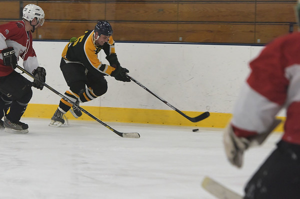 TIM JEAN/Staff photo<br /> Black Bears's Connor Cranston, center, with a scoring chance during 10th Annual Father and Son hockey game at Talbot Rink in Gloucester.   3/25/17