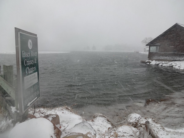 MARY MARKOS/Staff photo<br /> The snow blows in off the Essex River at the boat ramp next Shea's Riverside Restaurant and Bar on the Causeway in Essex around noon Tuesday.