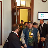 Kery Murakami/CNHI<br /> Retired coal miner Thomas Gibson of Montgomery, West Virginia, leads a delegation of miners into U.S. Sen. Shelley Moore Capito's Capitol office Thursday to push for rescuing their health care and pension benefits.