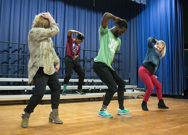 Desi Smith Photo. The kids weren't the only ones to show off some of their new dance moves.Teachers Rene Peierce (left) and Amber Telles (right) joined two members of Illstyle and Peace, a Philadelphia-based Dance Troupe on stage, as they performed some dance moves Monday morning at East Gloucester Elementary School. The performance was sponsored by the East Gloucester PTO and funded in part by a grant from the Gloucester Cultural Council. March 6,2017