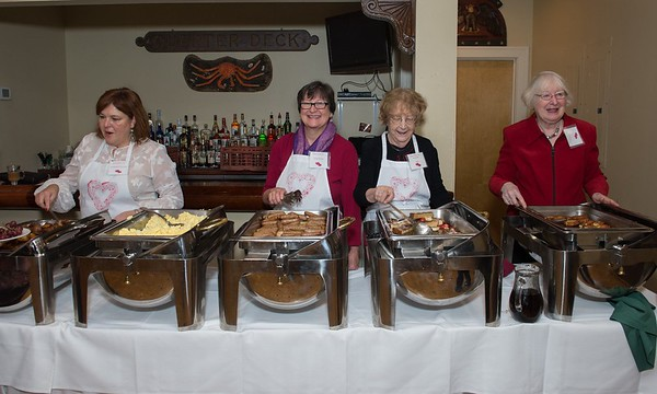 Desi Smith Photo.  Senior Care volunteers from left to right are, Josephine Toarmina, Sarah, Patty Colbert and Bea Robbins serve breackfast at the Senior Care Meals-On-Wheels Valentine Fundraiser Breakfast held at Gloucester House Friday morning. Originally planned for February, it was postponed due to a snow storm. The money raised supports the Meals on Wheels on Cape Ann and North Shore. Last year 165,000 meals were delivered.  March 10,2017
