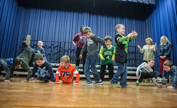 Desi Smith Photo. First graders got to try out some of the dance that were performed by Illstyle and Peace, a Philadelphia-based Dance Troupe Monday morning at East Gloucester Elementary School. The performance was sponsored by the East Gloucester PTO and funded in part by a grant from the Gloucester Cultural Council. March 6,2017