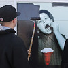 MIKE SPRINGER/Staff photo<br /> Jerry Ramos of the Ludlow-based Murray Home Improvements paints over a nostalgic mural of a boy eating ice cream in front of the now-defunct Friendly's restaurant at Grant Circle in Gloucester, which closed its doors Sunday night.<br /> 3/26/2018