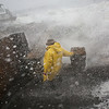 MIKE SPRINGER/Staff photo<br /> Neighborhood resident Synda Garrity braces herself as a wave crashes against a seawall on Bearskin Neck shortly after high tide Friday as a Nor'easter storm battered Rockport.<br /> 3/2/2018