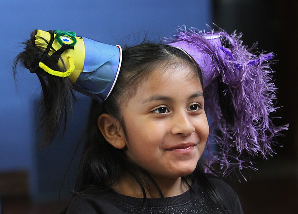 """MIKE SPRINGER/Staff photo<br /> Second-grader Juliana Healey wears a hairdo inspired by the animated film """"Minions"""" during """"Crazy Hair Day"""" Friday at East Gloucester Elementary School.<br /> 3/30/2018"""