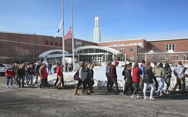 MIKE SPRINGER/Staff photo<br /> Students walk out of Gloucester High School at 10 a.m. Thursday to protest gun violence.<br /> 3/15/2018