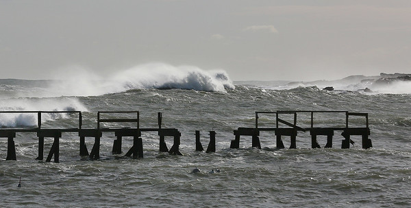 MIKE SPRINGER/Staff photo<br /> Heavy waves break near the badly damaged Magnolia Pier on Monday in Gloucester.<br /> 3/5/2018