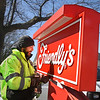 MIKE SPRINGER/Staff photo<br /> David Lipps of the Haverhill-based Sign Center removes one of the Friendly's restaurant signs from the Cape Ann Plaza in Gloucester on Monday morning. The restaurant unexpectedly closed its doors Sunday evening.<br /> 3/26/2018