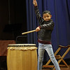 MIKE SPRINGER/Staff photo<br /> Third-grader Jhon Ovalle learns to play the taiko, a traditional Japanese drum, during a program Thursday at East Gloucester Elementary School. Two members of the Woburn-based group Odaiko New England visited the school to perform and to explain how taiko drums are in many aspects of traditional Japanese culture.<br /> 3/29/2018