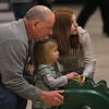 MIKE SPRINGER/Staff photo<br /> Two-year-old Allie Simon receives help from her grandfather Paul Simon and cousin Alyssa Deppen, 10, all of Gloucester, while using a dinosaur-shaped ramp to bowl Saturday at the Cape Ann Lanes in Gloucester.<br /> 3/17/2018
