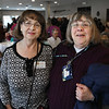 MIKE SPRINGER/Staff photo<br /> Shirley Tarr, left, and Cathy Siegal, both of Adult Foster Care, attend the annual Meals on Wheels benefit breakfast Friday at the Gloucester House restaurant.<br /> 3/16/2018
