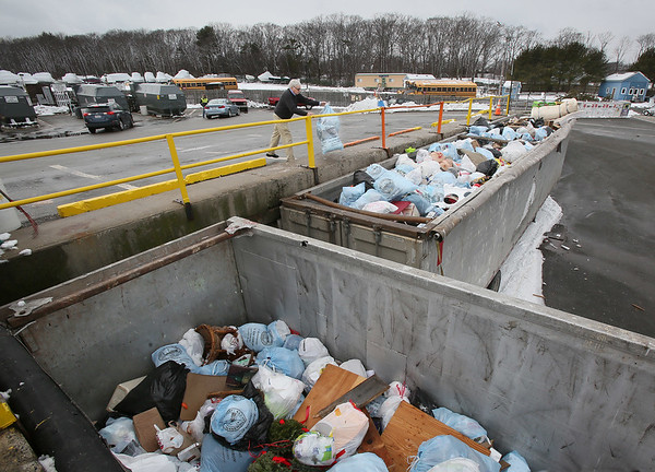 MIKE SPRINGER/Staff photo<br /> A man dumps garbage Friday at the Rockport Transfer Station.<br /> 3/9/2018