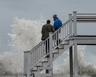 Desi Smith Photo.  Alex Lamb (letf) and Christopher Bryant both of Manchester, get a close up look at the waves, as they crash against the beachside seawall at the Manchester Bath and Tennis Club on Raymond St in Manchester during Saturday afternoon's storm. The club substained a lot of damage to the building.  March 3,2018   G