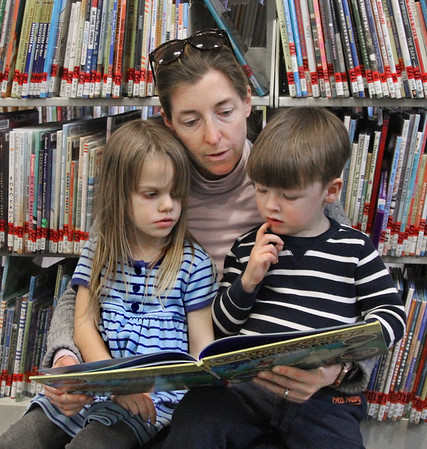 MIKE SPRINGER/Staff photo<br /> Molly Whelsky reads a story to her son Beau, 3, and his friend June Souza, also 3, in the children's room of the Rockport Public Library.<br /> 3/28/2018