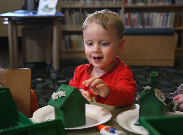 "MIKE SPRINGER/Staff photo<br /> Three-year-old Archer Bonenfant decorates a ""leprechuan house"" during a special St. Patrick's Day event for children Saturday at the Manchester Public Library. The Manchester Historical Society and Massachusetts Department of Early Education and Care helped with the event, which included Irish-themed stories and a scavenger hunt.<br /> 3/17/2018"